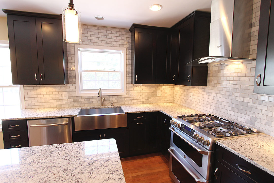 dark kitchen cabinets. White Kitchen Backsplash Tile, Dark Cabinets, Stainless Appliances, Farm Sink, Cabinets