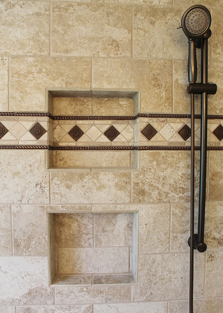 double shower niche with decorative tile