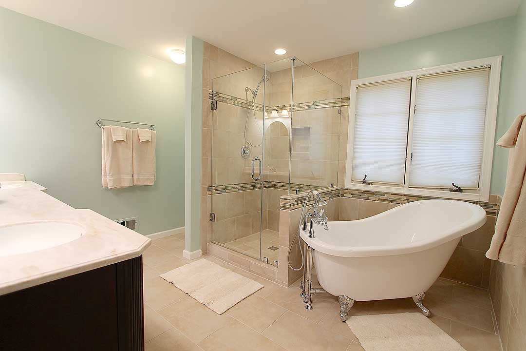 Full Master Bath Remodel Featuring Clawfoot Tub Walk In Shower With Frameless Door Double Vanity Above The Counter Cabinetry