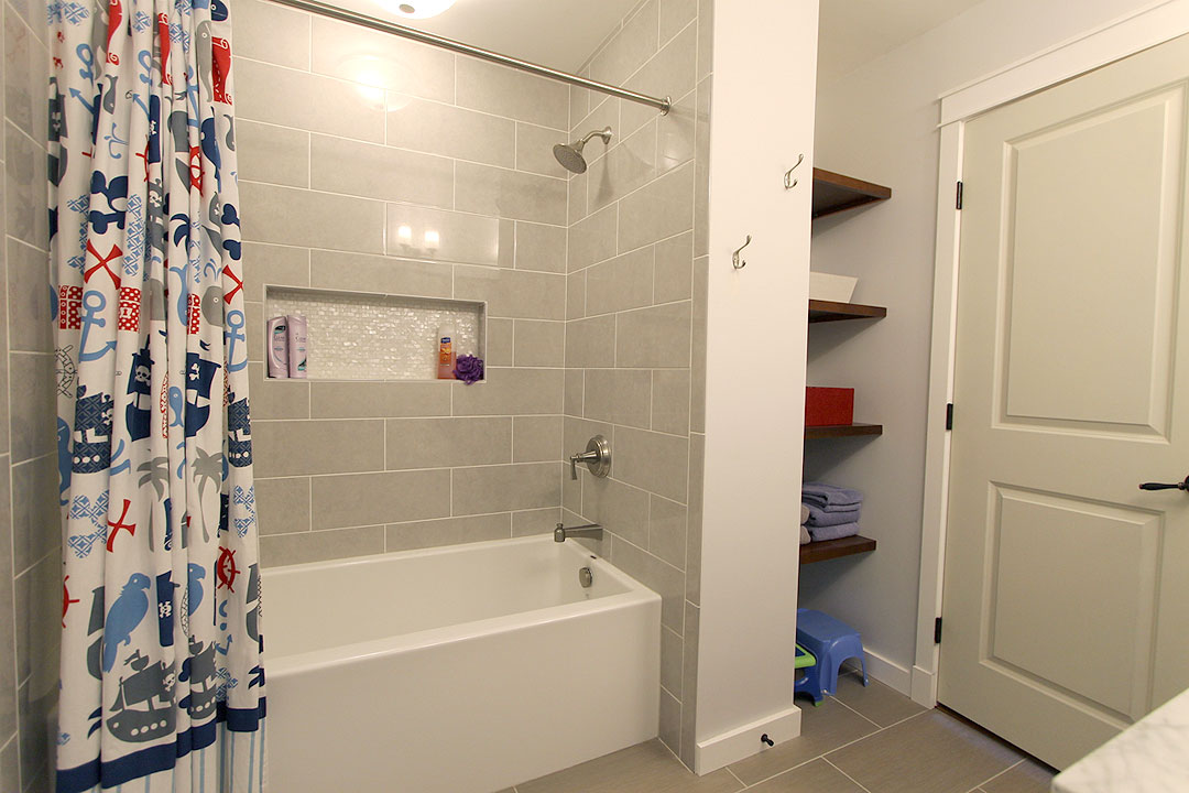 Charmant Bathroom Remodel With Oversized Bathtub, Large Shower Niche, Floating  Shelving, Double Vanity And