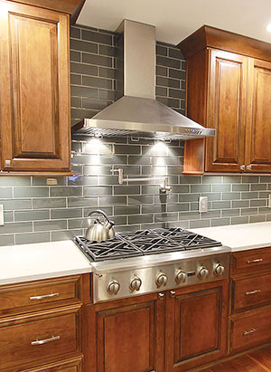 6 burner rofessional gas cooktop with vent hood, glass tile backsplash, pot filler, quartz counter tops