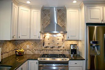 Kitchen remodel with travertine tile backsplash, granite counters, white kitchen cabinets by Ramcom Kitchen and Bath